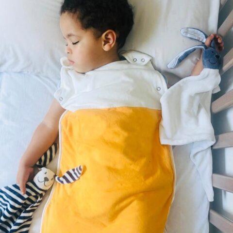 baby sleeps with organic baby comforter in organic baby sleeping bag